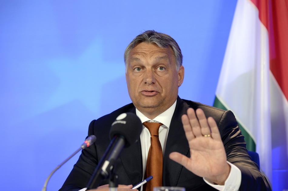 afp. Brüsszel, Belgium, 2015.09.03. Orbán Viktor Brüsszelben, menekültkérdés  Hungary's Prime Minister Viktor Orban gestures as he speaks during a press conference at the European Union (EU) Council building in Brussels, on September 3, 2015. Orban warned
